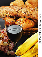 Red wine among fruits and pastry