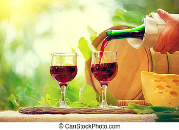 Red wine and cheese. Romantic lunch outdoors