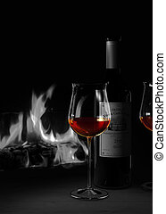 red wine and fire place