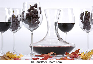 glasses filled up with red wine and grapes