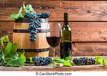 Red wine and grapes in a barrel
