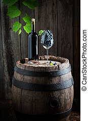 Red wine and grapes in glass