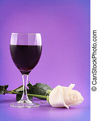 red wine and white rose