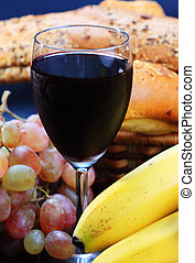 Red wine bananas and grape with pastry on background