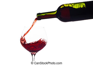 red wine being poured into a wine glass - in a glass of red...
