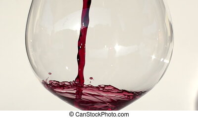 red wine being poured into glass shot in super slow motion...