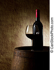 the still life with red wine, bottle, glass and old barrel