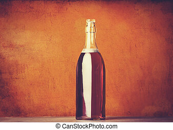 Red wine bottle on a wooden background
