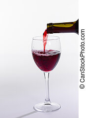 Red wine bottle pour glass on white background