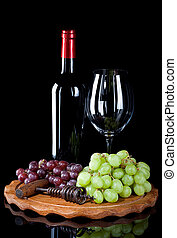 Red wine bottle with glass and grapes