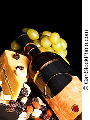 red wine bottle with grape and cheese