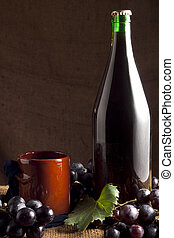Red Wine Bottle with Grapes