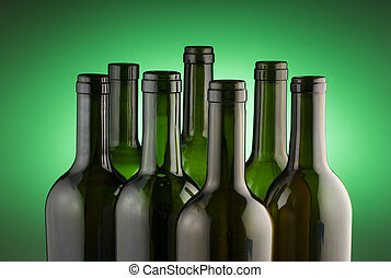 Red wine bottles on green