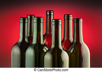Red wine bottles on red