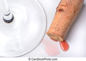 Red wine cork and a glass