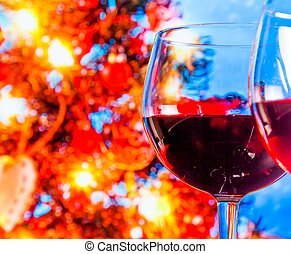 red wine glass against blur lights tree background