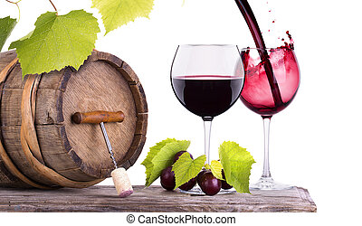 Red wine, glass and barrel with grapes