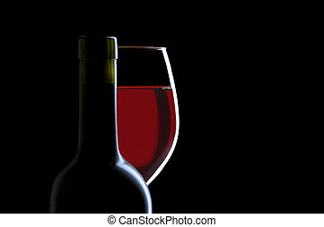 Red Wine Glass and Bottle on Black