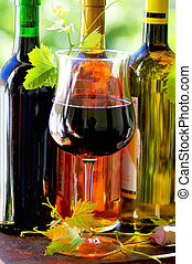 Red wine glass and grapevine leaves