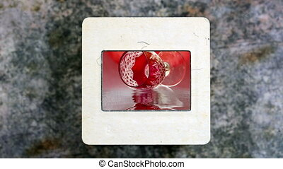 Red Wine Glass Reflects In The Water on vintage slide film