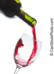 red wine glass - red wine pouring into wine glass isolated