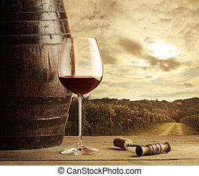 Red wine glass - Wine glass on vineyard background