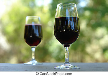 Red Wine Glasses - 2 Wine Glasses on an outdoor table