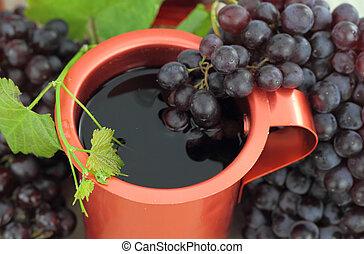 Red wine in a bronze pot
