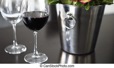 wine in a wineglass - Red wine in a wineglass on a table...