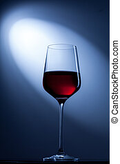 red wine in glass on blue