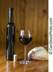 wine - red wine in glass with bottle and bread