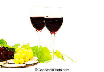 Red wine in glasses and grape isolated on white background