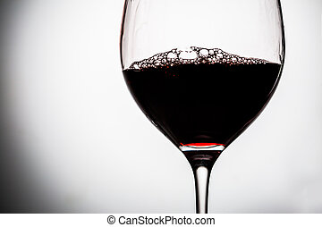 Red wine in wineglass.