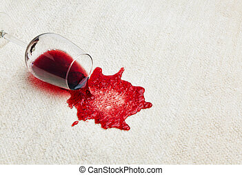 red wine is poured - red wine is spilled on a carpet....