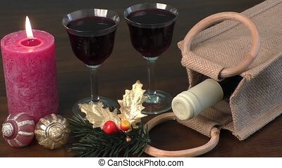 Red wine, ornaments and candles as a New Year decoration