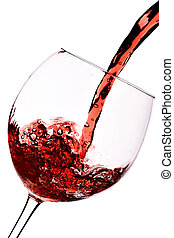 Red wine pour into glass close-up isolated over white...