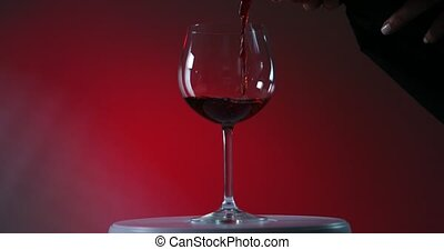 Red Wine Pouring Down into the winelass by waiter