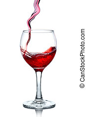 Red wine pouring in glass isolated on white