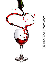 Red wine pouring in goblet from bottle in shape of heart