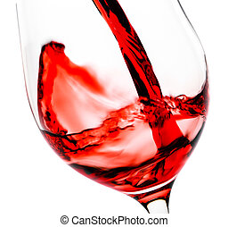Red wine pouring in the glass goblet