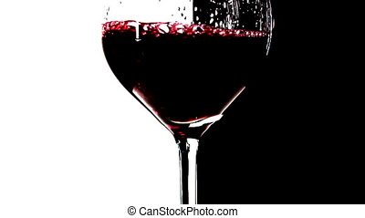 Red wine pouring into glass, slow motion 1
