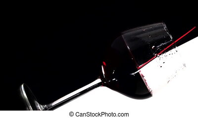 Red wine pouring into glass, slow motion 5