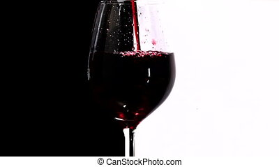 Red wine pouring into glass, slow motion 3
