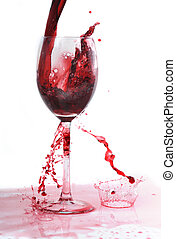 Red wine -  red wine flowing in transparent glass