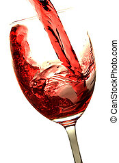 Red wine is poured into a glass. Isolated on white background.