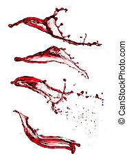 Red wine splashes - Isolated shot of red wine splashes on...