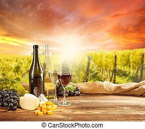 Red wine still life with vineyard on backgorund - Wine still...
