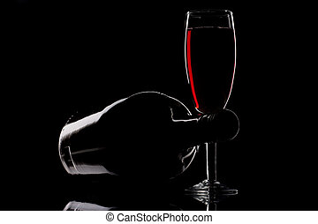 Red wine - Wine glass and bottle isolated on black...