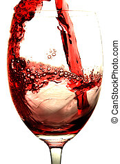 Red Wine - Red wine is poured into a glass. Isolated on...