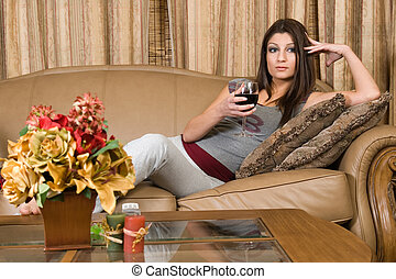 Red wine - Young attractive brunette woman relaxing on the...